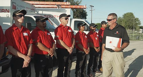 Click image of technicians receiving Master Elite Certification to go to Roof Inspections and Maintenance page