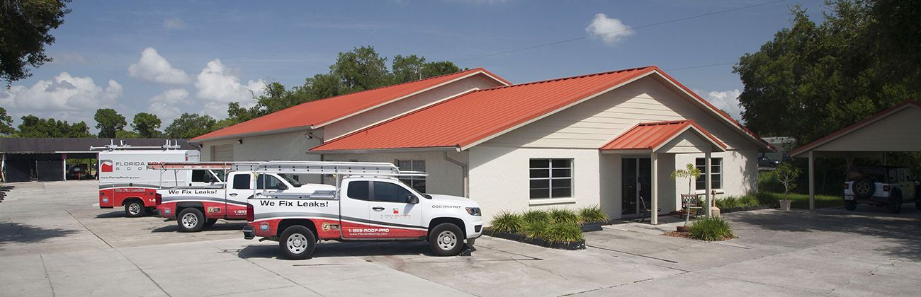 Florida Southern Roofing trucks parked in front of Sarasota Roofing Contractor headquarters