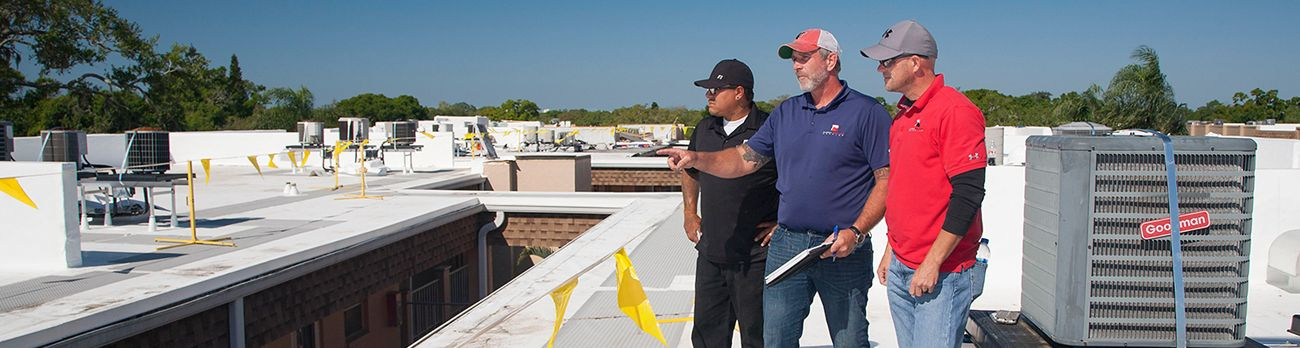Florida Southern Roofing employees on site during a commercial roof repair.