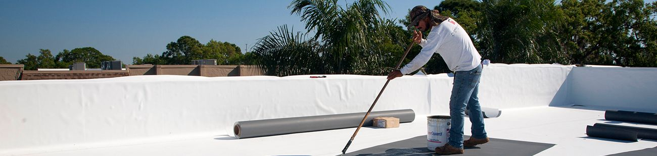 Florida Southern Roofing Roofing specialist repairing a flat roof.