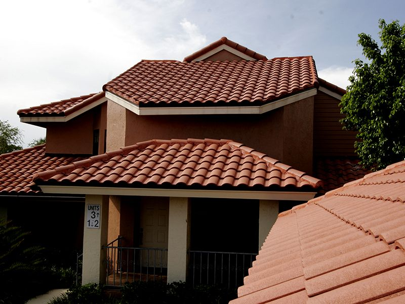 Condominium tile roof  by Florida Southern Roofing.