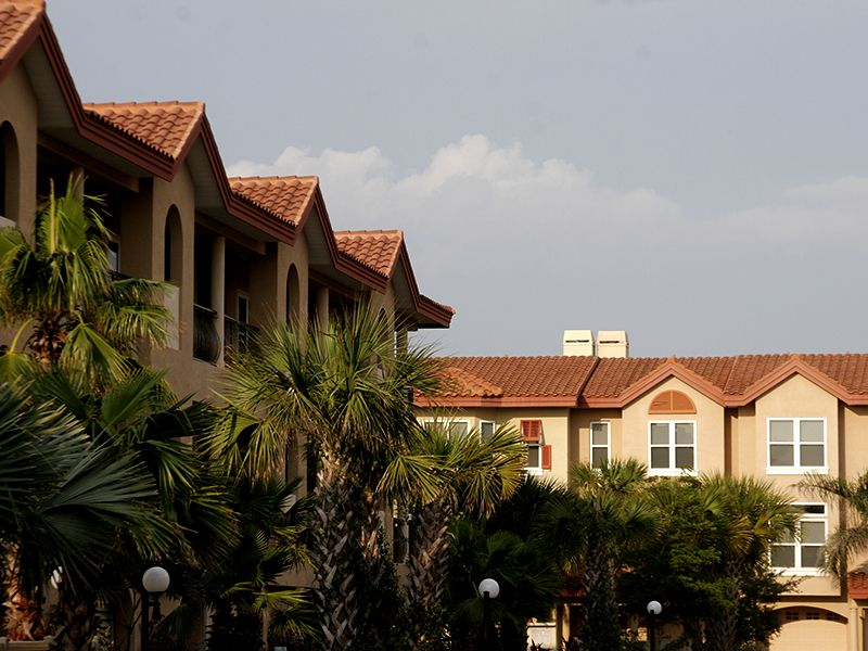 Condominium with tile roofing by Florida Southern Roofing.