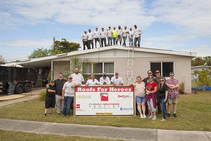 The team involved in the in the 2019 Roofs for Heroes donation.
