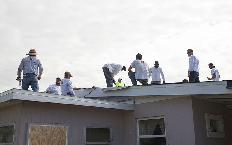 A team of Florida Southern Roofing roofers working on Mr. Bostic's roof.
