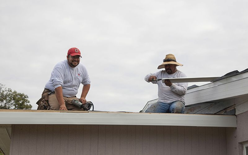Florida Southern Roofing roofers working on Mr. Bostic's roof.
